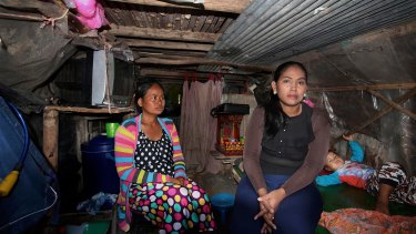 Inside Hour Vanny's cramped shanty home with her sister-in-law Som Tha Satry, 33, who gave birth to twins in October.