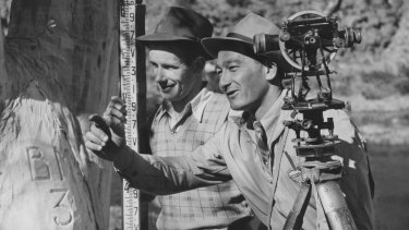 Work begins on the Snowy Project in 1949 as assistant survey chief Harry Stacey and his assistant Jack Robinson prepare to work out from a bench mark at the Adaminaby dam site, October 1949.
