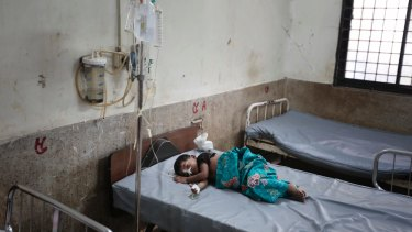 An injured Rohingya child Nur Sadika, 5, receives treatment after crossing over from Myanmar into Bangladesh.