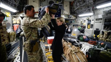 Foreign Affairs Minister Julie Bishop visits the Troops at KAIA-N base in Afghanistan. Bishop is helped into her body armour on the RAAF flight to Kabul.