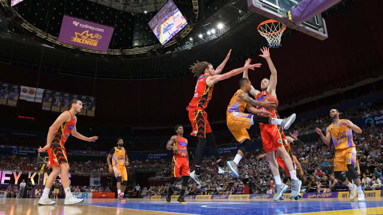Under pressure: Jerome Randle tries to pass the ball during yesterday's NBL match between Melbourne United and the Sydney Kings.