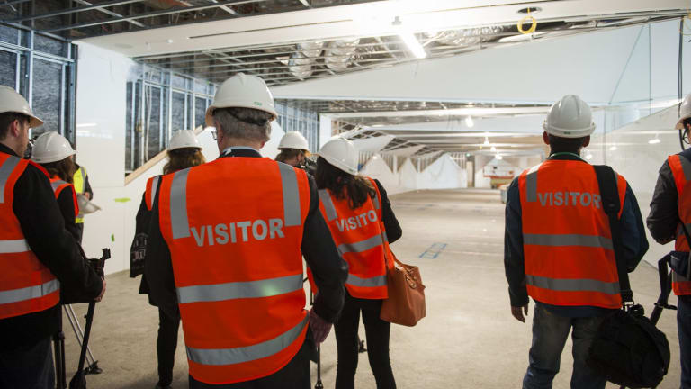Stephen Byron escorts media on a guided tour of the construction site of the $18 million fitout for the new international terminal.