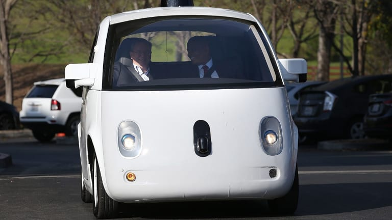 "Look, no hands: Google is expected to partner with Ford to make autonomous vehicles, such as its less than sleek ""Toaster""."