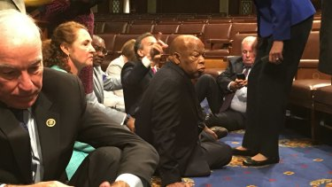 Democrat members of Congress, including Representatives John Lewis, centre, participate in the sit-down protest.