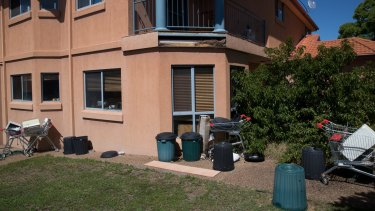 Trolleys and rubbish in the backyard of a house in Ebony Close, Hillvue, one of many properties rented by Frank Lin.