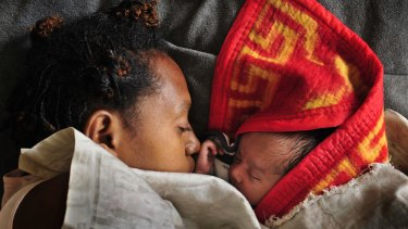 A mother with her baby in the maternity ward of the Goroka hospital in 2009.