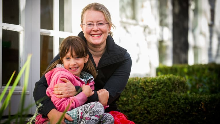 Canberra breast cancer survivor and photographer Marina McDonald with daughter Sydney Dayal, 7, at  home in Yarralumla.