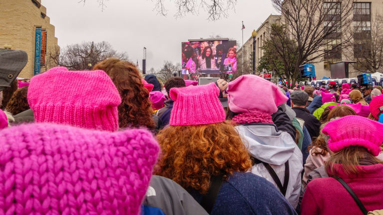 "Women wearing knitted ""pussy hats"" to protest the election of Donald Trump."