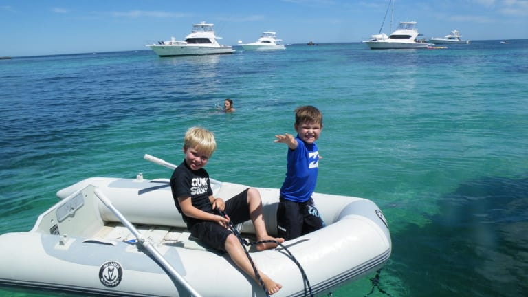 Mrs Bowe's sons John and James in the turquoise waters off Rottnest.