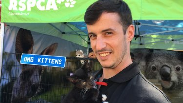 RSPCA volunteer Tim Ferris with RSPCA kitten Figaro at the Ekka, where the funding for the Pets in Crisis program was announced.