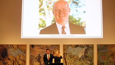Wayne Goss's daughter Caitlin Goss and son Ryan Goss speak at a memorial service for their father.