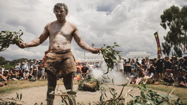 The 'invasion day' protest in Canberra. Pictured is Kumba, the fire keeper.