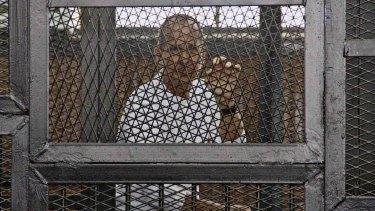 Al-Jazeera journalist Peter Greste in a Cairo courtroom in May 2014.