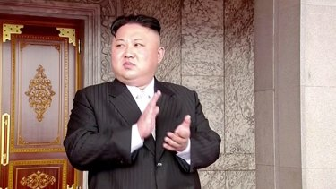 North Korea's leader Kim Jong-un applauds during a parade at Kim Il Sung Square in Pyongyang on Saturday, April 15.
