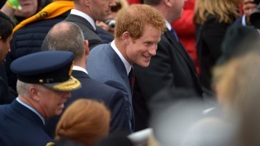 Prince Harry greets people before the Lone Pine service.