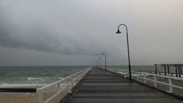 Storm clouds roll in over Port Phillip Bay off Kerferd Road Pier.