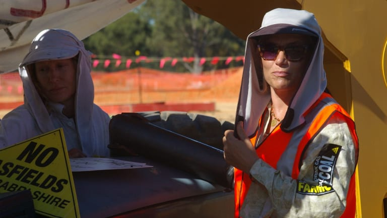 Kerri Tonkin, left, and fellow protester Cyd Fenwick, locked on to an excavator.