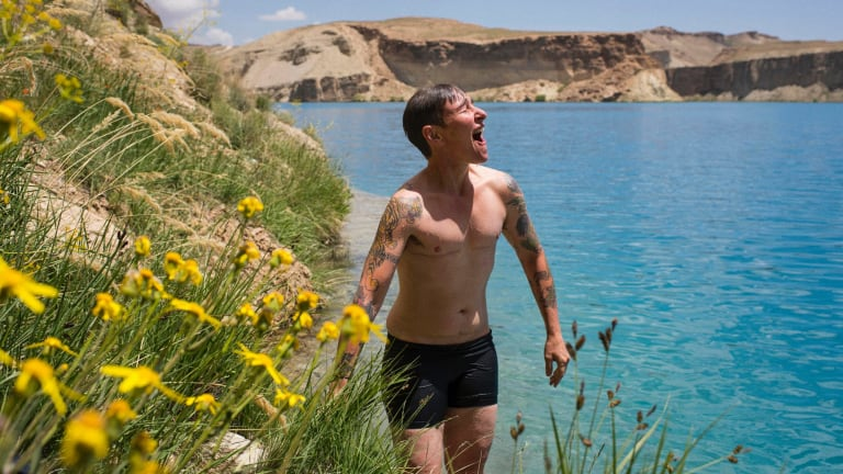 "Ayres at Band-e-Amir, Afghanistan, in his first week dressed as a man. ""My journey through this [transition] has been really easy,"" he says.  ""I just wish it was the same for everyone."""