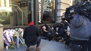 A Fan Lays Bouquet Of Flowers Outside David Bowie S Apartment Building In Manhattan As The