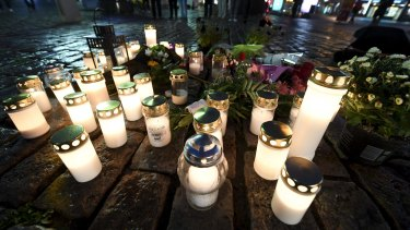 Memorial candles at the Market Square for the victims of Friday's stabbings in Turku, Finland.
