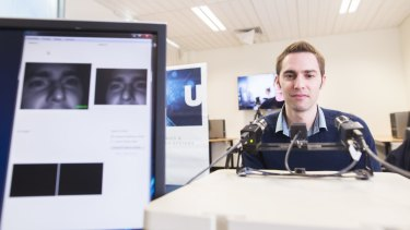 Dr Armin Haller, manager of the W3C Australian office which will be involved in the development of the world wide web, looks into eye-tracking cameras at the ANU.