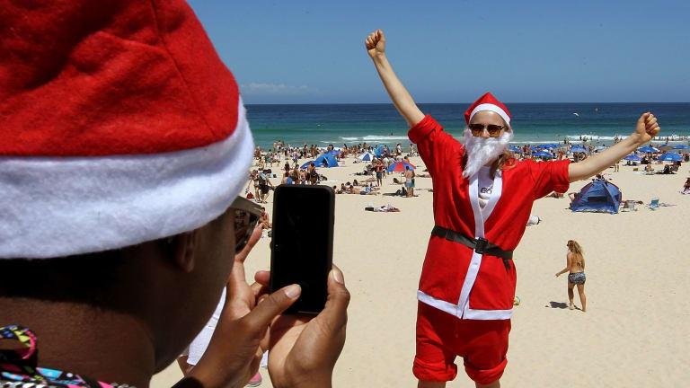 Natalie Williams from Britain celebrates Christmas at Bondi Beach.