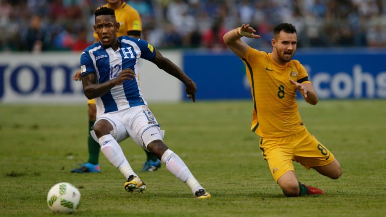 Australia's Bailey Wright, right, fights for the ball with Honduras' Romell Quito.