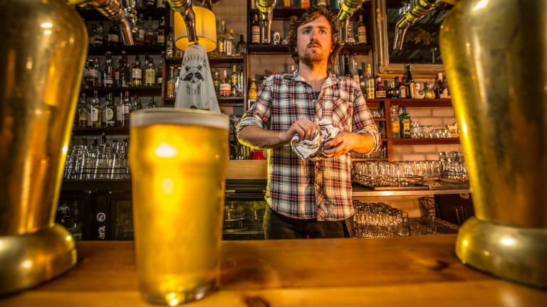Thomas Moloney, a barman at the Raccoon Club in Preston, which is boycotting CUB beers.