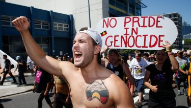 A man shouts during a protest against treatment of Aboriginal Australia.