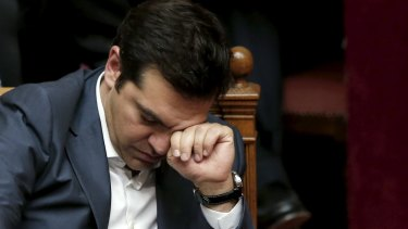 Greek Prime Minister Alexis Tsipras reacts during a parliamentary session in Athens.