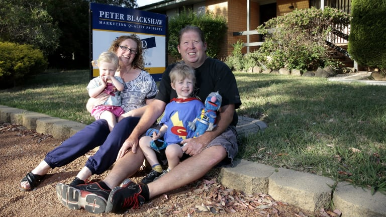 Moving on: Chris and Charmaine Sims with their son Zac and daughter Alma. They are leaving Mr Fluffy behind after buying a new home in Kambah in the ACT.