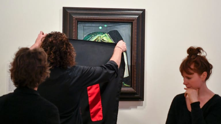 Artists covering a Picasso painting at NGV International in October.