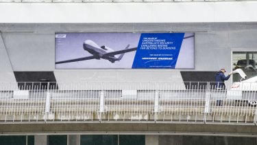A defence industry advertising poster at Canberra Airport.