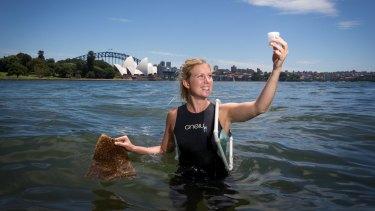 Marine ecologist Rebecca Morris installing new seawall pots along the Sydney Harbour at the Royal Botanic Gardens.