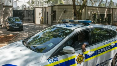 A police car patrols outside the residence of the Gupta family in Saxonworld, Johannesburg, South Africa, on Wednesday.