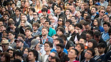 Attendees listen as Sundar Pichai, chief executive officer of Google Inc, not pictured, speaks at a developers conference in Mountain View, California, earlier this month.