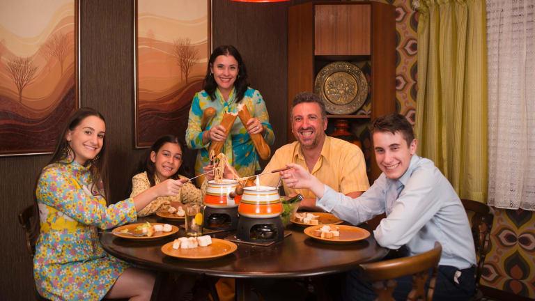 The Ferrone family enjoying a fondue in their 1970s house.
