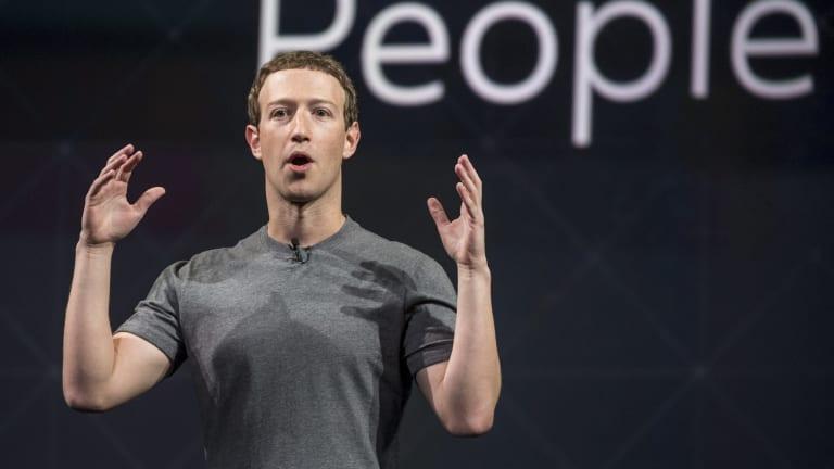 Mark Zuckerberg in his famously minimal T-shirt.