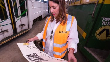 Mrs Larwill was given a poster of her husband painting the tram in 1986, and a yellow paper zone 1 ticket from the 1990s, found by her son Henry on one of the W-class trams.