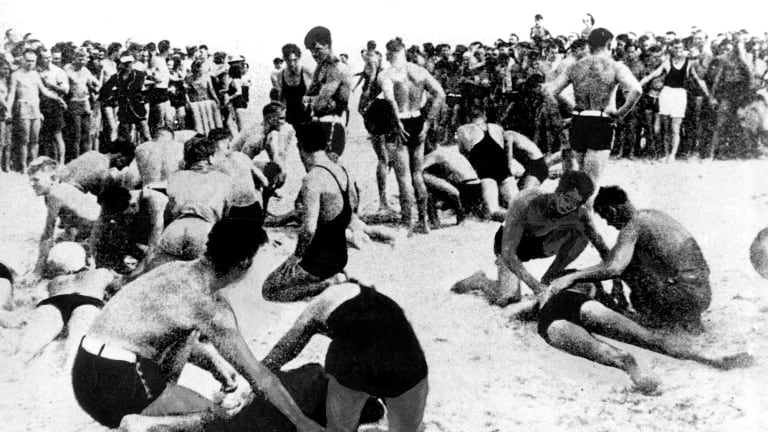 Exhausted bathers being revived by lifesavers on Bondi Beach on February 6, 1938.