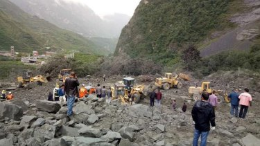 The landslide on Saturday morning smashed some 40 homes, where more than 100 people are feared to be buried.