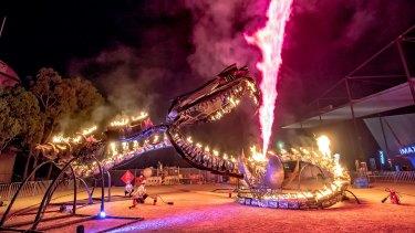 A dragon lights up Carlton Gardens.