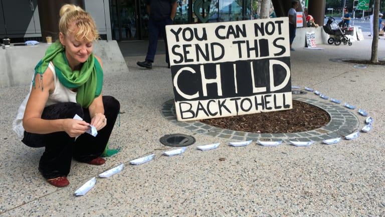 Scotia Monkivitch was one of about 50 protesters still at the vigil for baby Asha at Brisbane's Lady Cilento Hospital on Sunday morning.