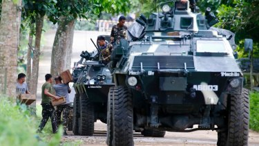 Troops load ammunition and supplies as a convoy of APCs head to Marawi  on Thursday, three days after Islamist militants laid siege to the provincial capital.
