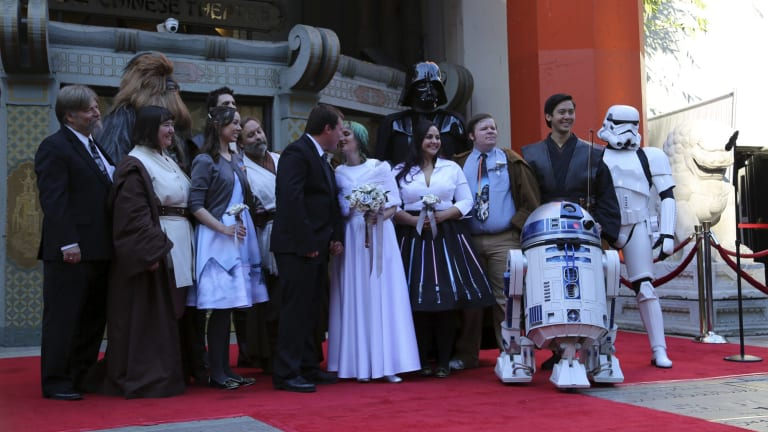 Characters from Star Wars were among the wedding party when Caroline Ritter married Andrew Porters.