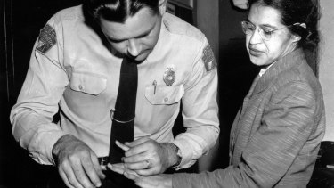 A police officer takes Rosa Parks finger prints in February 1956, two months after she refused to give up her seat on a bus for a white passenger.