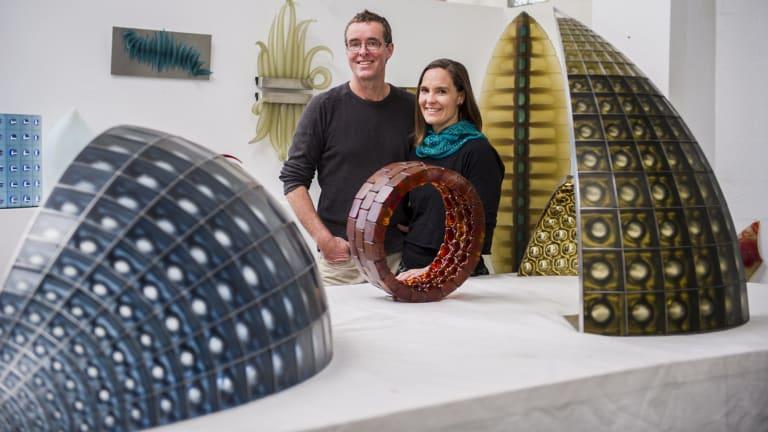 Glass artists Matthew Curtis and Harriet Schwarzrock in their studio in Queanbeyan.