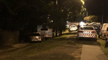 The scene outside a home on Mt Gravatt-Capalaba Rd at Mackenzie, where a 10-year-old boy was found dead.