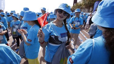 Employees of Chinese company Tiens attend a parade on the Promenade des Anglais in Nice.
