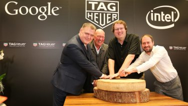 Tag Heuer's Guy Semon, LVMH president of watches Jean-Claude Biver, Google's David Singleton and Intel's Michael Bell announced their companies' partnership at Baselworld, then cut a huge wheel of Bivel's famously exclusive cheese.